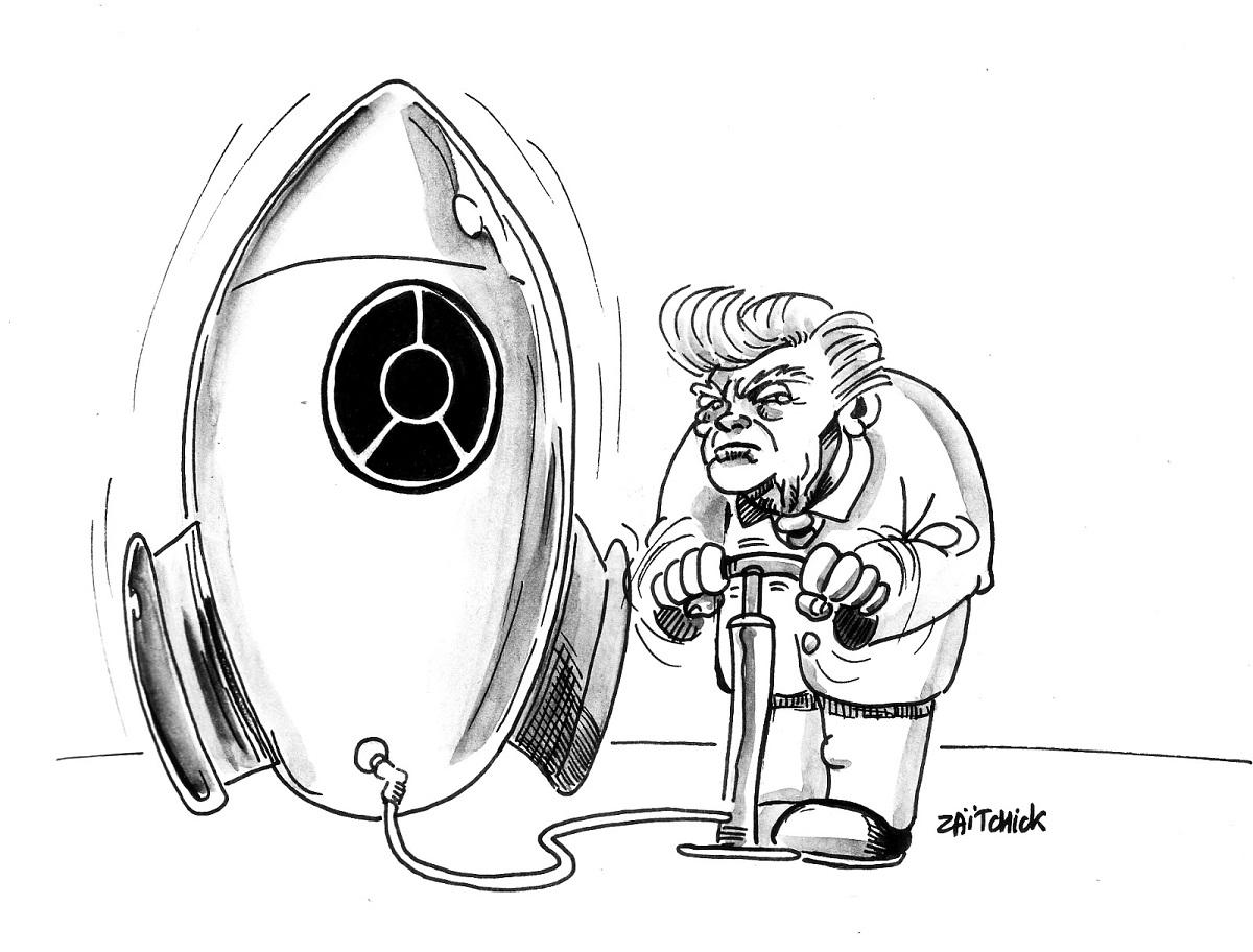 dessin d'actualité humoristique montrant Donald Trump en train de gonfler une bombe nucléaire
